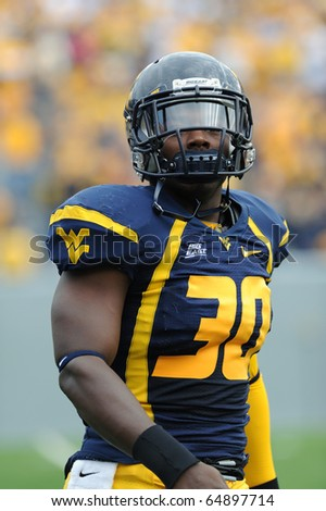 MORGANTOWN, WV - OCTOBER 23: West Virginia University linebacker J.T. Thomas warms up just prior to the football game on October 23, 2010 in Morgantown, West Virginia. - stock photo