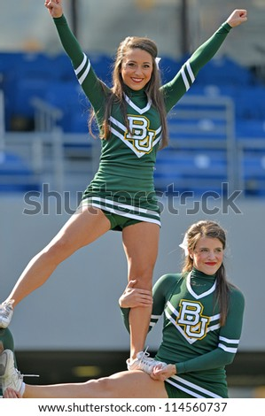 MORGANTOWN, WV - SEPTEMBER 29: Baylor University cheerleaders perform prior to the start of a Big 12 conference football game September 29, 2012 in Morgantown, WV. - stock photo