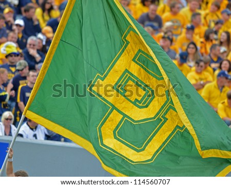MORGANTOWN, WV - SEPTEMBER 29: The Baylor University flag is carried on the field after a Bears touchdown during a Big 12 conference football game September 29, 2012 in Morgantown, WV. - stock photo