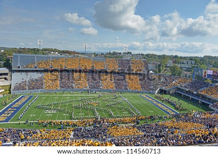 MORGANTOWN, WV - SEPTEMBER 29: The WVU band forms the WVU logo on the field prior to the start of a Big 12 conference football game September 29, 2012 in Morgantown, WV. - stock photo