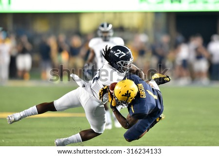 MORGANTOWN, WV - SEPTEMBER 5: West Virginia Mountaineers wide receiver Shelton Gibson (1) makes a spectacular catch in the season opening game September 5, 2015 in Morgantown, WV.  - stock photo