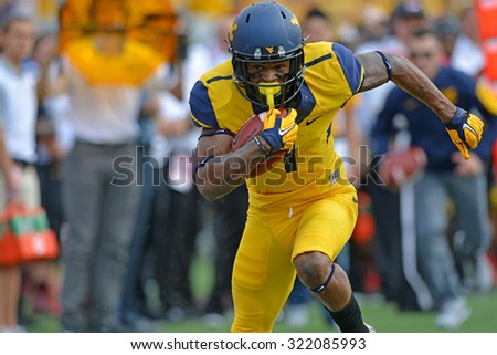 MORGANTOWN, WV - SEPTEMBER 26: West Virginia Mountaineers wide receiver Shelton Gibson (1) turns up field after making a catch during the NCAA football game September 26, 2015 in Morgantown, WV.  - stock photo