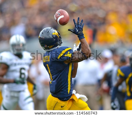 MORGANTOWN, WV - SEPTEMBER 29: West Virginia Mountaineers wide receiver Tavon Austin (#1) makes a long catch during a Big 12 conference football game September 29, 2012 in Morgantown, WV. - stock photo