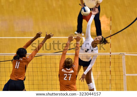 MORGANTOWN, WV - SEPTEMBER 25: West Virginia outside hitter Morgan Montgomery (3) goes for a kill during a volleyball match  September 25, 2015 in Morgantown, WV.  - stock photo