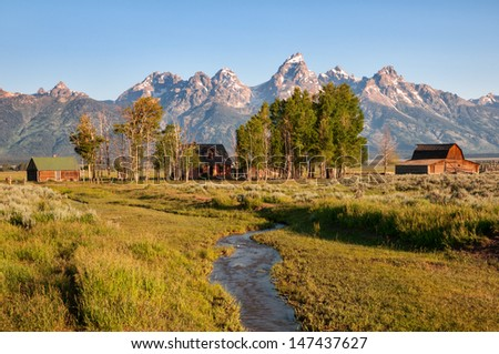 Mormon Row house and barn in the Grand Teton National Park, Wyoming. - stock photo
