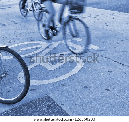 Morning bicycle traffic in the city. People on their way to work. - stock photo