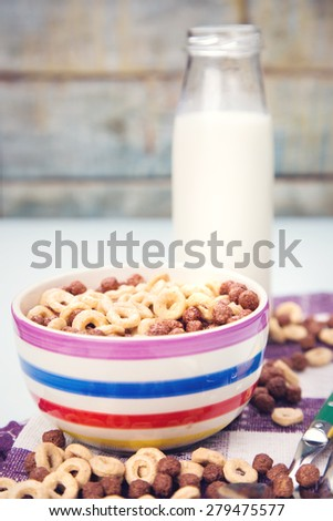 morning breakfast-flakes with milk in a dish - stock photo
