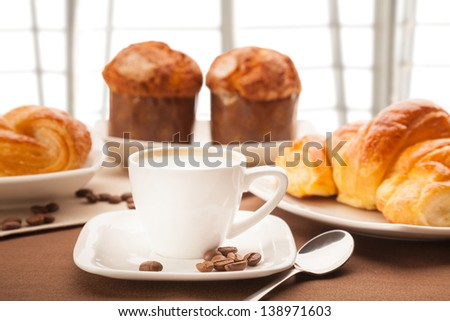morning breakfast with coffee milk, croissants and muffins - stock photo