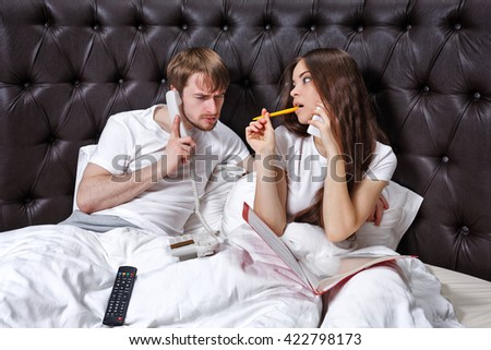 Morning business couple. Husband and wife on the phone. Business trip. - stock photo