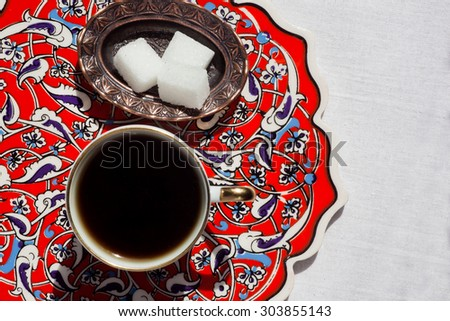 Morning coffee on the table with ceramic tiles in the style of the masters of Turkish Iznik - stock photo