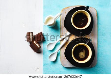 Morning Coffee Table. Two Cups of Espresso with Chocolate Cake and Little Milk Jug on White Table. Selective focus, top view. - stock photo