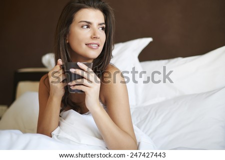 Morning coffee taste the best in bed  - stock photo