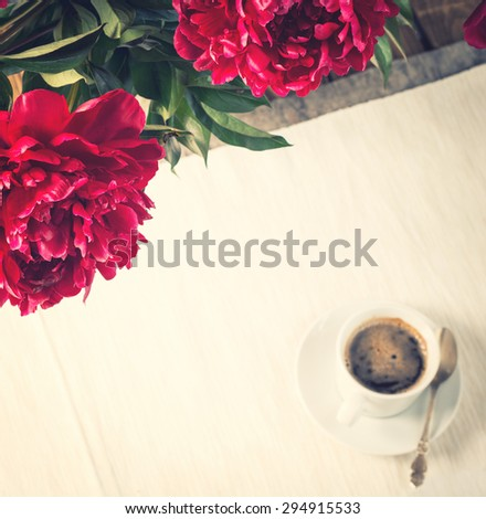 Morning coffee with peony flowers, top view, selective focus, toned. - stock photo