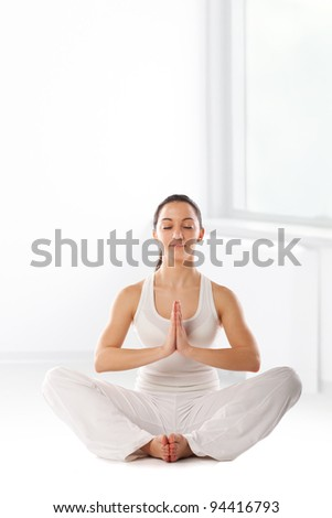 morning exercise.Young girl in white performing morning exercise - stock photo