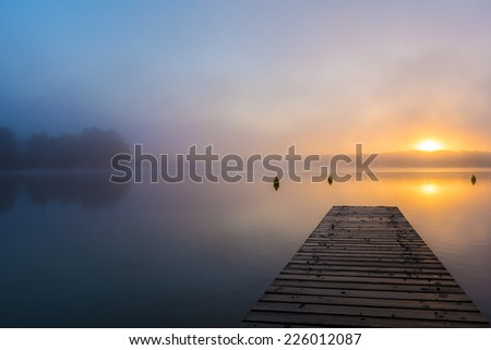 morning fog above a lake in Germany, Mecklenburgische Seenplatte - stock photo