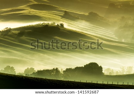 Morning fog in countryside Tuscany - stock photo