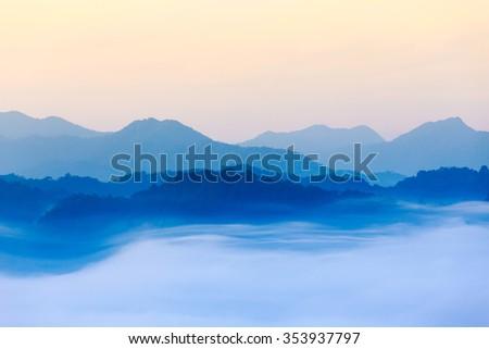 morning fog in dense tropical rainforest, kaeng krachan, thailand - stock photo