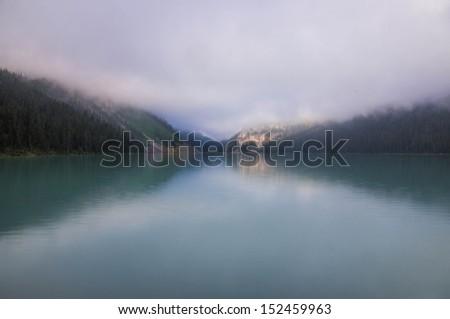 Morning fog on Lake Louise, Banff National Park, Alberta, Canada - stock photo