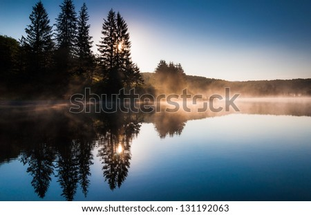 Morning fog on Spruce Knob Lake after sunrise, Monongahela National Forest, West Virginia. - stock photo