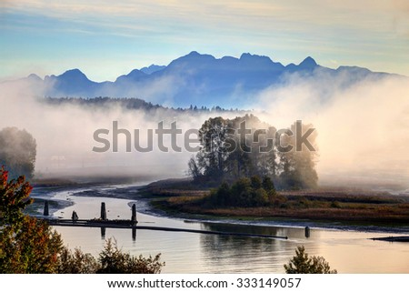 morning fog over river in autumn - stock photo