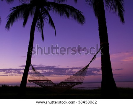 Morning glow and hammock on the beach at the Kauai, Hawaii - stock photo