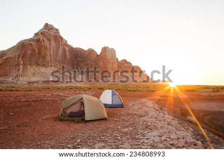 Morning Glow at Camp (On the Desert Shoreline of Lake Powell in Glen Canyon National Recreation Area) - stock photo