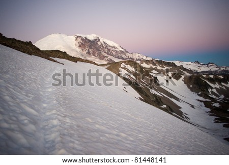 Morning Hike to Mount Rainier Sunrise Hiking Path Cascade Mountain Range Wilderness - stock photo