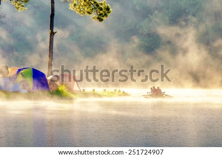 morning in pang oung with the light and shadow and steam over the lake in meahongson,Thailand - stock photo