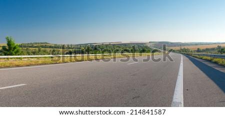 Morning landscape with high-way near Novomoskovsk city in central Ukraine - stock photo
