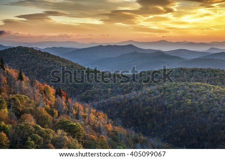 Morning light and fall foliage along the Blue Ridge Parkway in North Carolina - stock photo
