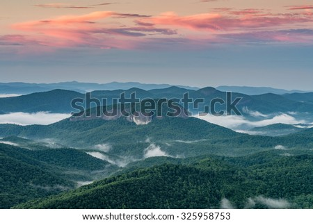 Morning light over Looking Glass Rock in the Blue Ridge Mountains of North Carolina. - stock photo