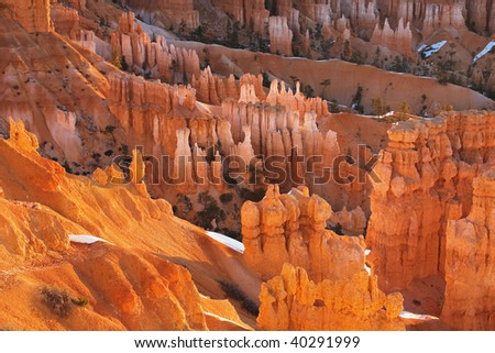 Morning light warms the Hoodoo Formations from the rim of Bryce Canyon Bryce Canyon National Park Utah - stock photo