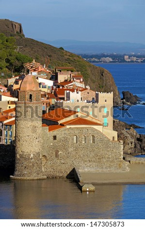 Morning lights on the coastal church Notre-Dames-Des-Anges in the Mediterranean village of Collioure, Vermilion coast, Languedoc-Roussillon, France - stock photo
