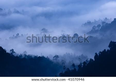 Morning Mist at Tropical Mountain Range, Malaysia. - stock photo