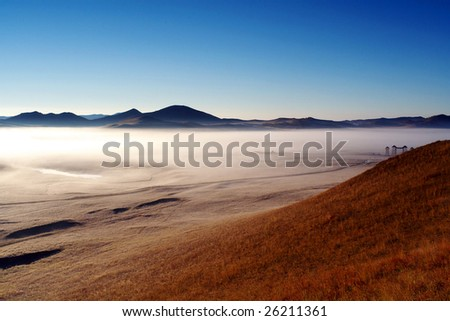 morning mist in Bashang grassland - stock photo