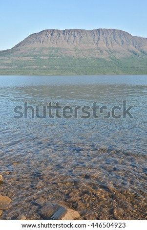Morning on the lake. Summer landscape of the Northern lakes on the Putorana plateau in Russia. - stock photo