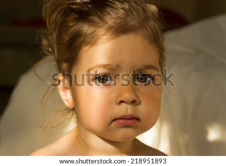 morning portrait of cute serious little girl thinking - stock photo