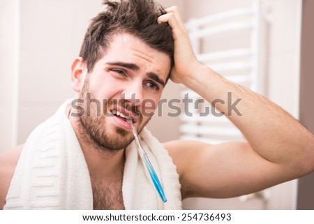 Morning routine of washing the teeth. Handsome young man is brushing teeth with toothbrush. - stock photo