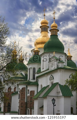 Morning Saint Sophia Cathedral church and sunshine. Kiev-City centre, Ukraine. Three shots composite picture. - stock photo