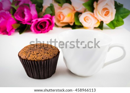 morning served with a cupcake, empty a cup can serve with coffee or tea or your favorite drinks - stock photo