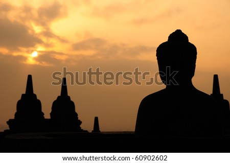 Morning silhouette of Buddha on the top of Chandi Borobudur - stock photo