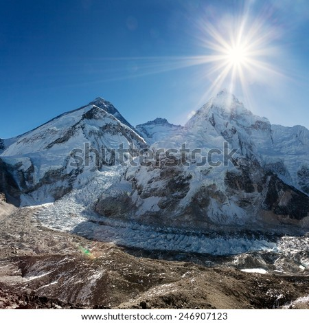Morning sun above Mount Everest, lhotse and Nuptse from Pumo Ri base camp - Way to Everest base camp - Nepal  - stock photo