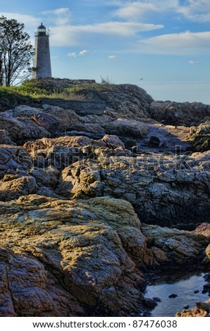 Morning sun on the rocks at Lighthouse Point, New Haven, Connecticut - stock photo