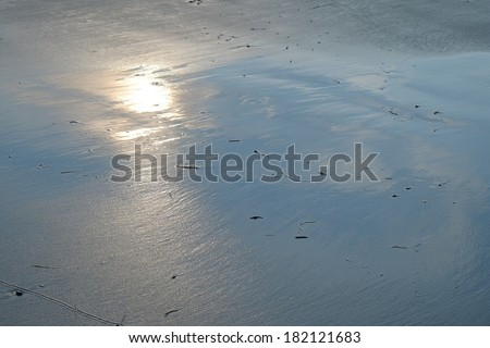 Morning sunlight reflection on the sands of a New England beach during low tide - stock photo