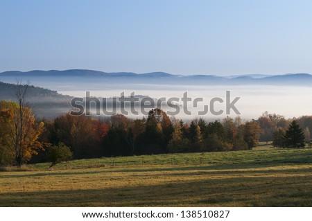 Morning sunrise during fall foliage season, Stowe, Vermont, USA - stock photo