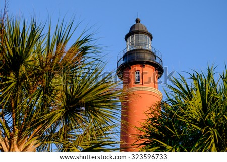 Morning sunrise on the colorful and beautiful Ponce Inlet Lighthouse in Florida - stock photo