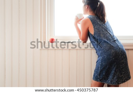 Morning sunshine and good coffee always makes me in a good mood - stock photo