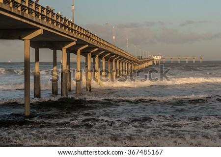 Morning surf at Ocean Beach Fishing Pier in San Diego, California.  - stock photo
