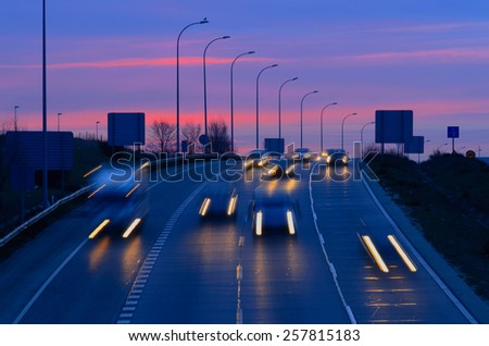 Morning traffic in an spanish road. Night transport and travel concept - stock photo