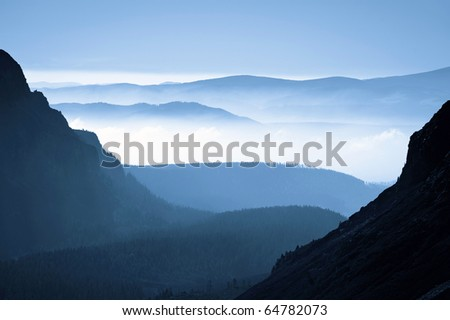 morning view from mountains to the foggy valley, autumn in High Tatras, Slovakia - stock photo